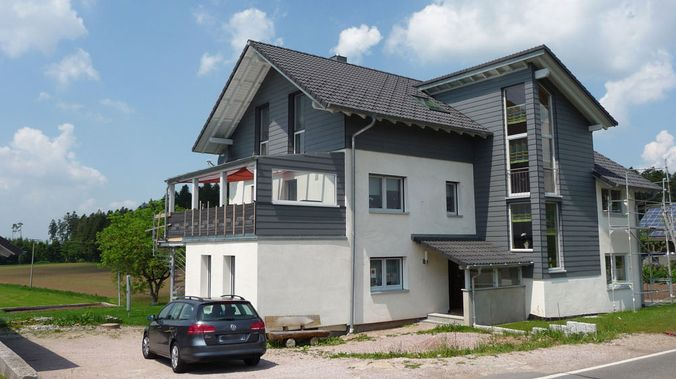 Фасадні панелі для оздоблення будинку